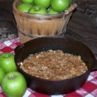 Maple Apple Crisp - Sliced apples are slathered in syrup, arranged in a baking dish and covered with a wonderful crumble made from brown sugar, butter and rolled oats. The crisp is then baked and served warm with scoops of rum raisin ice cream.