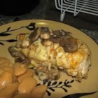 Muenster Chicken and Mushrooms - Mushrooms crown breaded chicken blanketed with Muenster cheese and sauteed in broth.