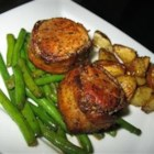 Bacon Wrapped Pork Medallions - Tempting morsels of pork are wrapped in smoky bacon in this elegant dish.