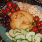 Baked Brie in Puff Pastry - Almonds lend a pleasant crunch to this favorite hot-out-of-the-oven appetizer; ready-made puff pastry speeds up the process.