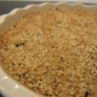 Apple Crisp - Apples baked with a brown sugar, butter and walnut topping.  A delicious desert, or a treat for breakfast!