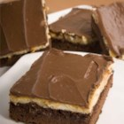 Cheesecake Topped Brownies - This recipe came about purely by luck. A few years back, I had to make a last minute dessert for a party. I had wanted to make cheesecake but I did not have graham cracker crumbs. I did have a package of brownie mix and frosting. They were a hit at the party and I have made them ever since.