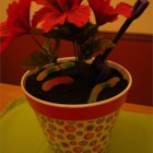 Dirt Cake I - This is a great conversation piece at parties.  Adults love it as much as the children do.  Get a new garden trowel, medium sized flower pot and artificial flower at a craft store for full effect.