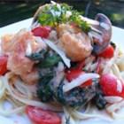 Exchange Gang Pasta with Shrimp - Creamy shrimp sauce with spinach, mushrooms, and tomatoes over spaghetti is the tasty result of a friendly challenge to cook Keri from her pals on the Recipe Exchange.