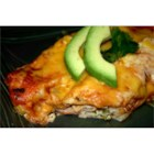 Savory Halibut Enchiladas - The filling for these enchiladas combines halibut with green onion, bell pepper, cilantro, sour cream, mayonnaise, and Cheddar cheese.