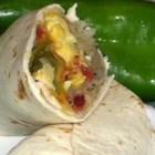 New Mexico Green Chile Breakfast Burritos - A hearty recipe for a style of breakfast burrito found in every eatery, taco stand, and gas station around Santa Fe, made with the famous green chiles from Hatch, New Mexico.