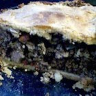 Tourtiere - Ground veal, pork and bacon are cooked until brown and crumbly, and then they 're cooked a tad more with onion, garlic, celery and sage. Water and cornstarch are added, and then the filling is simmered until it 's thick and all the flavors are blended. This savory filling is spooned into a pastry shell, topped with a second crust and baked. Serve it with garlic mashed potatoes.