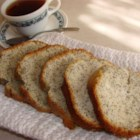 Poppy Seed Bread III - The classic pairing of almond flavoring with poppy seeds is enhanced with butter flavoring in this sweet quick bread.  The final product glistens with an orange-almond-butter topping.