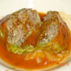 Stuffed Cabbage - Cabbage leaves are wrapped around a beef and rice mixture, then baked in a sauce made from tomato soup in this old-time favorite.