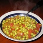 Curried Peas - First you saute onion with cinnamon and cumin. A very happy beginning. Then you stir in tomatoes, fresh shelled peas and coconut milk perfumed with chili powder, coriander, and turmeric. Simmer until peas are tender.