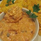 Chili Cheese Dip V - Chili is sandwiched between cream and Cheddar cheeses. This warm dip is great with tortilla chips.