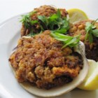 Tim O'Toole's Famous Stuffed Quahogs - Large clam shells are stuffed with chopped clams, spicy sausage and bread stuffing in this easy variation on an East coast classic.