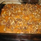 Pumpkin Breakfast Casserole - A nice eggy bread casserole with canned pumpkin and spices gets mixed up the night before, then is baked the next day to clear your kitchen and your morning for other things.