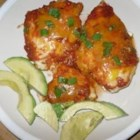 Salsa Chicken - Chicken seasoned with taco seasoning and topped with salsa, then baked.