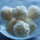 Snowflake Truffles - Whole almonds are surrounded by a ricotta cheese and coconut mixture and coated with white chocolate to make 'snowballs' you can enjoy any time of year.