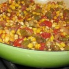 Okra, Corn and Tomatoes - Okra and onions are fried with bacon, then simmered with canned tomatoes and corn in this delicious side dish that is especially good served with cornbread. Fresh or frozen vegetables can be used.