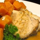 Autumn Pork Roast - This pork roast is surrounded by onions and butternut squash, and baked in a savory and sweet sauce.