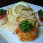 Parmesan Scallops - Fresh scallops breaded with crackers and Parmesan cheese are quick, easy, and mouth watering.