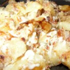 Blue Cheese Fried Potatoes - Need something other than scalloped or mashed potatoes to go along with a roast or steak dinner? Try these blue cheese and bacon skillet fried potatoes laced with caramelized onions! They will not disappoint.