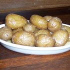Syracuse Salt Potatoes - An utterly simple and delicious way to celebrate the season's first new potatoes. Invented in the 1800s by Irish salt mine workers in central New York State, tender potatoes are boiled in intensely salted water, then served hot with melted butter.