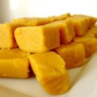 Pumpkin Fudge - Using the same method as is used in making traditional fudge, pumpkin is substituted for chocolate in this seasonal recipe for a corn syrup based treat.