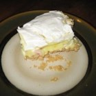 Lemon Freeze Pie - A graham cracker crust is pressed into a large 9x13-inch pan and a thick lemony filling studded with fruit cocktail is spooned in. Whipped topping is spread over the top and the pie is frozen until ready to serve.