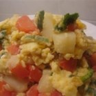 Egg Scramble - A yummy mix of veggies and eggs, topped with cheese and hot sauce. You may also use Indian curry spice or garam masala instead of cayenne and omit the cheese if you like.