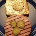 Kevin's Toasted Honey Wheat Berry Bologna and Egg Sandwich - Sweet onions and pickles finish off this heaping sandwich.