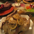 Moist Garlic Roasted Chicken - A whole chicken is stuffed with lemon slices, then layered with garlic slices and thyme sprigs.  The whole thing is wrapped up in parchment paper to keep it moist as it bakes, trapping in all of the wonderful juices!