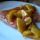 Autumn Spice Ham Steak - A ham steak smothered in maple flavored red and green apples, then sprinkled with cinnamon.