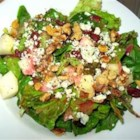 Fall Salad with Cranberry Vinaigrette - Salad greens, pears, walnuts and gorgonzola are tossed in a cranberry dressing in this beautiful seasonal salad.  Serve as the first course to a Thanksgiving meal.