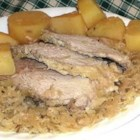 Slow Cooker German-Style Pork Roast with Sauerkraut and Potatoes - Pork loin becomes tender and delicious cooked slowly with sauerkraut and caraway seeds. This gets raves from my German father. My Irish husband loves it too!