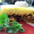 Tamale Pie II - White cornmeal is cooked up and spread into the bottom and sides of a 2-quart casserole. Then ground beef is cooked with chopped onion, green pepper, corn, chili powder and tomato sauce. The beef filling is spooned into the casserole, topped with a thin layer of cornmeal and a generous sprinkling of Cheddar cheese.