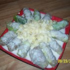 Ukrainian Meat Filled Cabbage Rolls - In Ukrainian kitchens, cabbage leaves are often used as cases for soft fillings. These rolls are a little different, because the leaves are filled with a meat stuffing and not primarily a cereal mixture. This makes them 'holiday' fare. For a different flavor, use tomato juice instead of chicken broth.