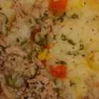 Turkey Shepherd's Pie - Ground turkey is sauteed in olive oil along with shredded carrot, sliced mushrooms, garlic, chicken bouillon and herbs. This tasty filling is then piled into a deep-dish pie pan, topped with homemade mashed potatoes and popped into the oven until it 's golden.