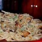 Pasta alla Carbonara - Fresh mushrooms cooked with onions and bacon add savory appeal to piping hot pasta tossed with eggs, cream and Parmesan. The heat of the pasta cooks the eggs, and a sprinkling of parsley and pepper flakes finishes the dish.
