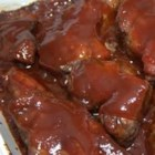 Tangy BBQ Ribs - Quickly grilled and then baked in a honey/ketchup/barbecue sauce laced with molasses, these tender, tasty ribs are the very model of finger-licking good!