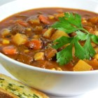 Steak Soup - Rich, hearty steak soup has chunks of tender round steak, potatoes, carrots, celery, and corn, all simmering in a flavorful tomato-flavored beef broth.