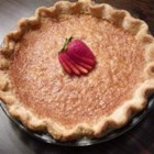 Sugar Cream Pie V - This pie is very sweet and creamy, and it 's laced with a hint of vanilla. Lots of sugar, heavy cream and flour are combined, and then milk and vanilla are mixed in. The filling is poured into an unbaked pie crust, dotted with butter, sprinkled with nutmeg and baked .