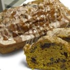 Pumpkin Chip Bread -  Add a big scoop of chocolate chips to pumpkin-nut bread, coat with a cinnamon-nutmeg glaze, and watch it vanish before your eyes in no time!