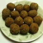 Scrumptious Sauerkraut Balls - Deep fried and savory, these delicious little sausage sauerkraut balls are the perfect party finger food.  These are the most scrumptious sauerkraut balls you will ever taste!!