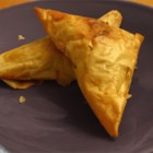 Brie and Mushroom Phyllo Puffs - Warm melted brie and sauteed mushrooms are wrapped in a phyllo triangle. Great for parties!  These are time consuming to make, but extremely elegant.