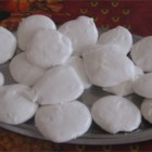 Divinity - A candy thermometer is helpful in making this soft white candy made with light corn syrup.