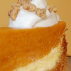 Pumpkin Torte II - This pumpkin dessert has a graham cracker crust and cream cheese and pumpkin layers. It's finished with whipped topping and walnuts.