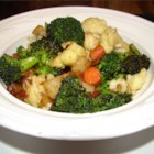 Baked Vegetables I - Potatoes, onions, broccoli and zucchini are mixed and plopped into a casserole dish. A bushing of olive oil and a sprinkling of dried soup finish it off.