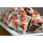 Candy Corn Bark - A delightful recipe only for those with a incurable sweet tooth! Candy corn mixed with chocolate sandwich cookies and pretzels will please your whole Halloween crowd.