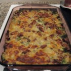 Ham, Potato and Broccoli Casserole - Layers of French fries, broccoli and ham topped with a creamy soup mixture and sprinkled with cheese.
