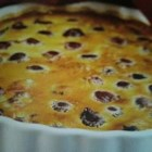 Cherry Clafouti - An original French dessert recipe of my grandmother's, tweaked a bit to be lower in fat! It's best made with fresh fruit and is delicious with a dollop of lite whipped topping. If you want to make it the original way, not low-fat, just use regular milk and butter and 4 large eggs. Also, to substitute for kirsch, you may use the juice from five squashed cherries or use 1 tablespoon of cherry syrup.