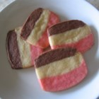 Neapolitan Cookies I - This cute refrigerator cookie resembles the popular ice cream flavor. There are chocolate, pink, and white stripes.