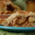 Grandma Ople's  Apple Pie - Tired of ordinary old apple pie? Well this fabulous recipe adds a delicious twist to the apply classic. Sliced, unadorned apples are mounded into a pie crust and topped with a lattice crust. Then, just before baking, a sweet, thick sugar syrup is poured carefully onto the crust. An hour later, the apples are tender and fragrant and the crust a glistening brown.